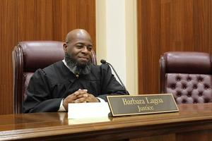 """Playing the role of a justice during the mock oral argument, Court Teacher Institute fellow Mr. Michael Rogers, who teaches at Lake Asbury Junior High School in Cove Springs, thinks deeply about the case before him and his fellow """"justices."""""""